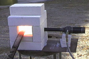 the image at the right shows the burner inserted through this hole this was the test firing to see if my forge design would even work - Homemade Propane Forge Design